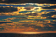 CLouds at sunset on the Gulf of St. Lawrence. Gaspe Peninsula. <br />Pointe-au-Pere<br />Quebec<br />Canada