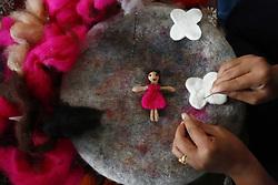 October 4, 2018 - Kathmandu, Nepal - A Nepalese woman makes decorative designs using wool at a production factory on the outskirts of Kathmandu, Nepal on Thursday, October 4, 2018. (Credit Image: © Skanda Gautam/ZUMA Wire)