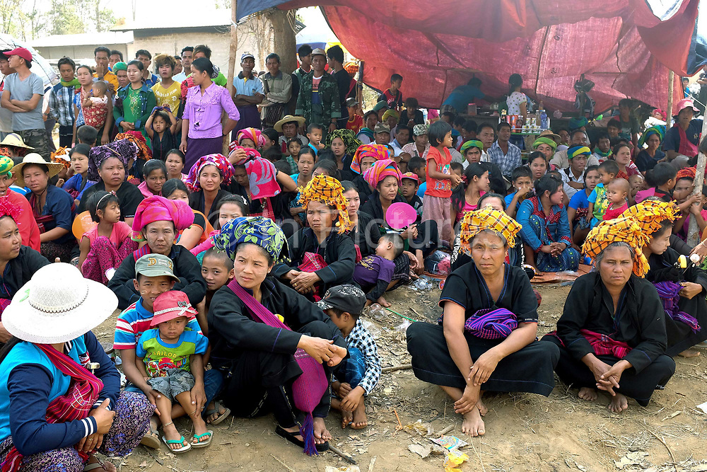 The rocket festival audience at the PaO National Day on 24th March 2016 in Kayah State, Myanmar. The PaO origin story states that they are derived from a shaman, Zawgyu, and a female dragon so the women fashion their turban to resemble a dragons head