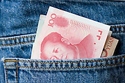 Chinese currency, one hundred Yuan bills in jeans pocket
