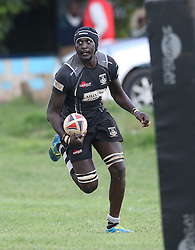 Humphrey Khayange (C) of Mwamba RFU in action against Mean Machine during their Kenya Cup Tournament at Railway Club In Nairobi, on 3rd December 2016. Mwamba won 51-8. Photo/Fredrick Onyango/www.pic-centre.com (KEN)