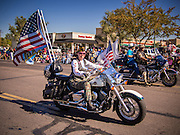"""11 NOVEMBER 2013 - PHOENIX, AZ: A member of the VFW rides in the Phoenix Veterans Day Parade. The Phoenix Veterans Day Parade is one of the largest in the United States. Thousands of people line the 3.5 mile parade route and more than 85 units participate in the parade. The theme of this year's parade is """"saluting America's veterans.""""    PHOTO BY JACK KURTZ"""