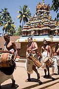 Musicians walk around the internal courtyard on a festival day at the Janardhana Temple at Varkala.