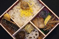 """Eki Bento - The origin of bento can be traced back to the Kamakura Period when cooked and dried rice called hoshi-ii literally """"dried meal"""" was developed. In the Edo Period bento culture spread and became more refined. Bento became even more popular in the 80s with the help of the microwave and the proliferation of convenience stores. The expensive wood and metal boxes have been replaced at most bento shops with inexpensive, disposable plastic ones Even handmade bento have made a comeback, and they are once again a common sight at picnics."""