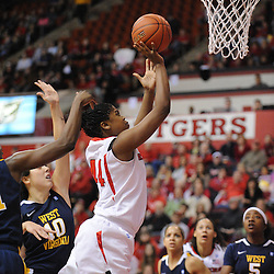 Rutgers Scarlet Knights forward/center Monique Oliver (44) scores on a play in the paint during first half Big East NCAA women's basketball action between Rutgers and West Virginia at the Louis Brown Rutgers Athletic Center