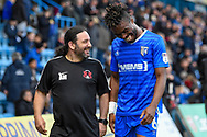 Gillingham FC defender Gabriel Zakuani (6) shares a joke with the Leyton Orient kit manager Adrian Martin during the The FA Cup match between Gillingham and Leyton Orient at the MEMS Priestfield Stadium, Gillingham, England on 4 November 2017. Photo by Martin Cole.