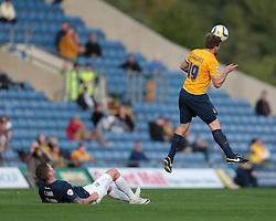 Oxford United's Johnny Mullins heads clear - Photo mandatory by-line: Nigel Pitts-Drake/JMP - Tel: Mobile: 07966 386802 05/10/2013 - SPORT - FOOTBALL - Kassam Stadium - Oxford - Oxford United v Southend United - Sky Bet League 2