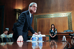 May 17, 2017 - FILE PHOTO - The Justice Department on Wednesday named ROBERT MUELLER as special counsel to oversee the department's investigation into Russian meddling in the 2016 election. Mueller III served as FBI director from 2001 through 2013. Pictured: May 16, 2012 - Washington, DC, U.S. - z FBI Director ROBERT MUELLER testifies before the Senate Judiciary Committee Hearing on oversight of the Federal Bureau of Investigation. (Credit Image: © James Berglie/ZUMAPRESS.com)