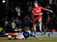 Photo: Daniel Hambury.<br />Portsmouth v Liverpool. The FA Cup. 29/01/2006.<br />Portsmouth's goal scorer Sean Davis (L) tackles Liverpool's Jan Kromkamp.