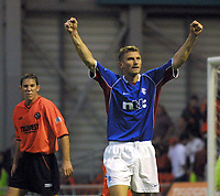 Fotball: Dundee Utd v Rangers 22.09.01. Tore Andre Flo scores his salutes the fans after scoring his third goal of the match as David Partridge lets his feelings show .<br /><br />Photo: Ian Stewart, Digitalsport