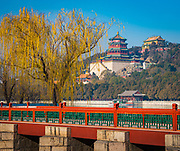 "The Summer Palace (Chinese: 頤和園), is a vast ensemble of lakes, gardens and palaces in Beijing. It was an imperial garden in the Qing Dynasty. Mainly dominated by Longevity Hill (万寿山; 萬壽山) and Kunming Lake, it covers an expanse of 2.9 square kilometres, three-quarters of which is water.<br /> <br /> Longevity Hill is about 60 m high and has many buildings positioned in sequence. The front hill is rich with splendid halls and pavilions, while the back hill, in sharp contrast, is quiet with natural beauty. The central Kunming Lake, covering 2.2 square kilometres, was entirely man-made and the excavated soil was used to build Longevity Hill.<br /> <br /> In December 1998, UNESCO included the Summer Palace on its World Heritage List. It declared the Summer Palace ""a masterpiece of Chinese landscape garden design. The natural landscape of hills and open water is combined with artificial features such as pavilions, halls, palaces, temples and bridges to form a harmonious ensemble of outstanding aesthetic value""."
