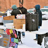 Employees for Navajo Transitional Energy Company, which supported Navajo Nation Council approval of a federal charter for the them, had a table of hot coffee, beef stew, donuts, juice and other refreshments for the public and workers from Four Corners Power Plant and Navajo Coal Mine that they bused to the Council chambers in Window Rock, Arizona, Friday.