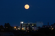 The full moon rises over the Horton campus of Orange Regional Medical Center in Middletown, N.Y., on June 21, 2005.© Tom Bushey