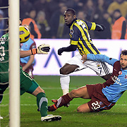 Fenerbahce's Mamadou NIANG (C) and Trabzonspor's Remzi Giray KACAR (R) during their Turkish superleague soccer derby match Fenerbahce between Trabzonspor at the Sukru Saracaoglu stadium in Istanbul Turkey on Sunday 30 January 2011. Photo by TURKPIX