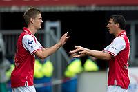 ALKMAAR  , AZ - Roda JC , 16-09-2012 , AFAS stadion ,  4-0 , AZ speler Markus Henriksen (l) komt er in voor AZ speler Maarten Martens (r) .