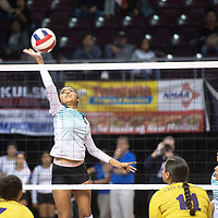 Navajo Prep's Nicole Martin (8) hits the ball at the net against Tucumcari Friday morning at the Santa Ana Star Center in the NMAA Class 3A State Volleyball tournament in Rio Rancho.