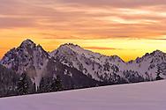 evening alpenglow lights the winter sky over the Tatoosh Range in Mount Rainier National Park, Cascade Mountain Range, Washington, USA