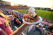Funnel cake with Hiland Dairy ice cream, whipped cream and chocolate syrup at Hammons Field located in Springfield, MO. Photo taken on June 1, 2018. Photo by Brandon Alms Photography