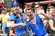 Canal Parade 2017 - De botenparade door de grachten van Amsterdam.De jaarlijkse Canal Parade is onderdeel van de Amsterdam Gay Pride, een feestelijk evenement met een LHBT karakter.<br /> <br /> Canal Parade 2017 - The boat parade through the canals of Amsterdam. The annual Canal Parade is part of the Amsterdam Gay Pride, a festive event with an LHBT character.<br /> <br /> Op de foto / On the photo:  botenparade in de grachten met Feestvierende toeschouwers  / Boat parade in the canals with Celebrating spectators Sipke Jan Bousema