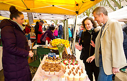 Pictured: Willie Rennie, Hannah Betsworth chatted with and sampled the wares of Annwen Bridgland at the Vanilla Cream stall<br /> <br /> Liberal Democrat leader Willie Rennie and  Hannah Bettsworth, Liberal Democrat candidate for Edinburgh Central and the Lothian regional list, headed to Stockbridge today to meet Easter shoppers and stallholders at the Sunday farmers market. <br /> <br /> Ger Harley | EEm 27 March 2016