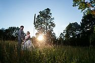 Catherine and Elliot were married at Saint John's Catholic Church in Fenton, Michigan in a beautiful ceremony. After, they celebrated their nuptials with friends and family at The Vale Barn, where we took portraits under the covered bridge and in the meadow at sunset.