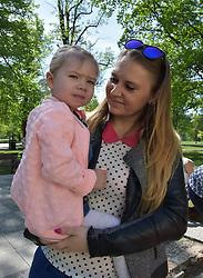 April 28, 2018 - Legnica, Poland - April 28.2018 Legnica Poland Ola Janiszewska was born with a half of her heart. The daughter's parents learned about her daughter's illness during routine tests for pregnant women. Ola has two operations done in a hospital in Poland. Another surgery is needed but none of the hospitals in Poland wants to do it. One chance for Ola who is currently 2 years old is surgery in Germany. Dad Oli is a policeman. They can not afford to pay for the operation. The operation should be done up to 3 years old. The operation at the clinic in Münster in Germany costs 37 000 EURO  ..Ola Janiszewska with her mother Luiza Janiszewska and my dad Krzysztof Janiszewski  (Credit Image: © Piotr Twardysko via ZUMA Wire)