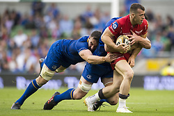 May 27, 2018 - Dublin, Ireland - Gareth Davies of Scarlets tackled during the Guinness PRO14 Final match between Leinster Rugby and Scarlets at Aviva Stadium in Dublin, Ireland on May 26, 2018  (Credit Image: © Andrew Surma/NurPhoto via ZUMA Press)