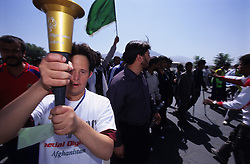 A mental disabled athlete holding the Olympic's torch during the Special Olympics Afghanistan opening day in Kabul...On 23-25 August 2005, Special Olympics Afghanistan held its first national Games at Olympic Stadium in Kabul. More than 300 athletes, including 80 female athletes, experienced a taste of happiness and achievement for the first time in their lives. They competed in athletics, bocce and football (soccer). Because of cultural restrictions, males and females competed at separate venues.