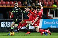 Forest Green Rovers George Williams(11) is under pressure from Swindon Town's Keshi Anderson(10) and Swindon Town's Canice Carroll(19) during the EFL Sky Bet League 2 match between Swindon Town and Forest Green Rovers at the County Ground, Swindon, England on 12 February 2019.