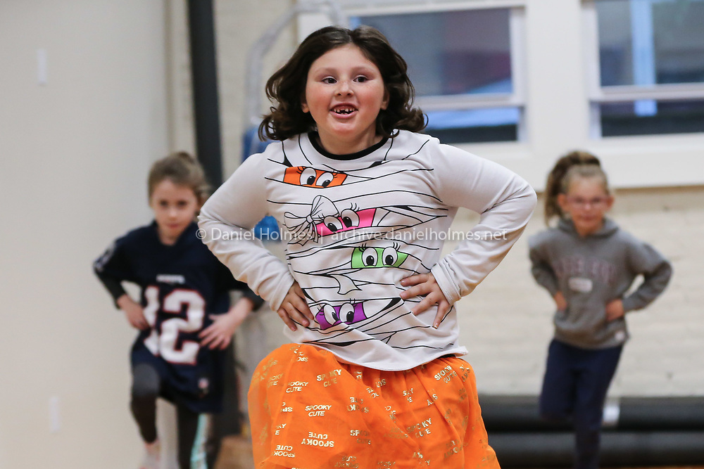 (10/21/19, NATICK, MA) Annalise Morse, 7, of Framingham, dances during dance class at Nancy Kelley Dance Studio in Natick on Monday. The business reopened almost three months to the day after a fire destroyed the business along with seven others in downtown Natick. [Daily News and Wicked Local Photo/Dan Holmes]