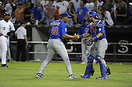 CHICAGO - JUNE 20:  Carlos Marmol #49 celebrates with Geovany Soto #18 of the Chicago Cubs after recording the final out of the game against the Chicago White Sox on June 20, 2011 at U.S. Cellular Field in Chicago, Illinois.  The Cubs defeated the White Sox 6-3.  (Photo by Ron Vesely)  Subject:  Carlos Marmol;Geovany Soto
