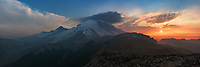 """It was just me and a marmot on the summit of Burroughs Mountain admiring this view of Mount Rainier at sunset. The enormity of this mountain is humbling. Rainier is the most prominent peak in the lower US and the most glaciated containing rivers of ice up to 750 feet thick. This volcano is dormant, but not extinct, and it holds the potential for major destruction if it erupts. The greatest hazard wouldn't necessarily be a lava flow, but what's known as a """"lahar."""" A lahar is a mud and debris flow caused by magma destabilizing the rock and rapidly melting snow and ice. These mudflows can travel many miles (as far as the Puget Sound) and signs in the campground warn visitors to head uphill in the event of an earthquake or a rumbling sound. After spending a week in Washington, this was the first sunset I saw that wasn't extremely smoky. It was a long hike back by headlamp, but the pictures were worth it."""