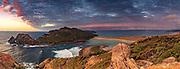 Sunset over Ernest Islands, panorama from above The Gutter, Mason Bay, Rakiura National Park, Stewart Island, New Zealand.