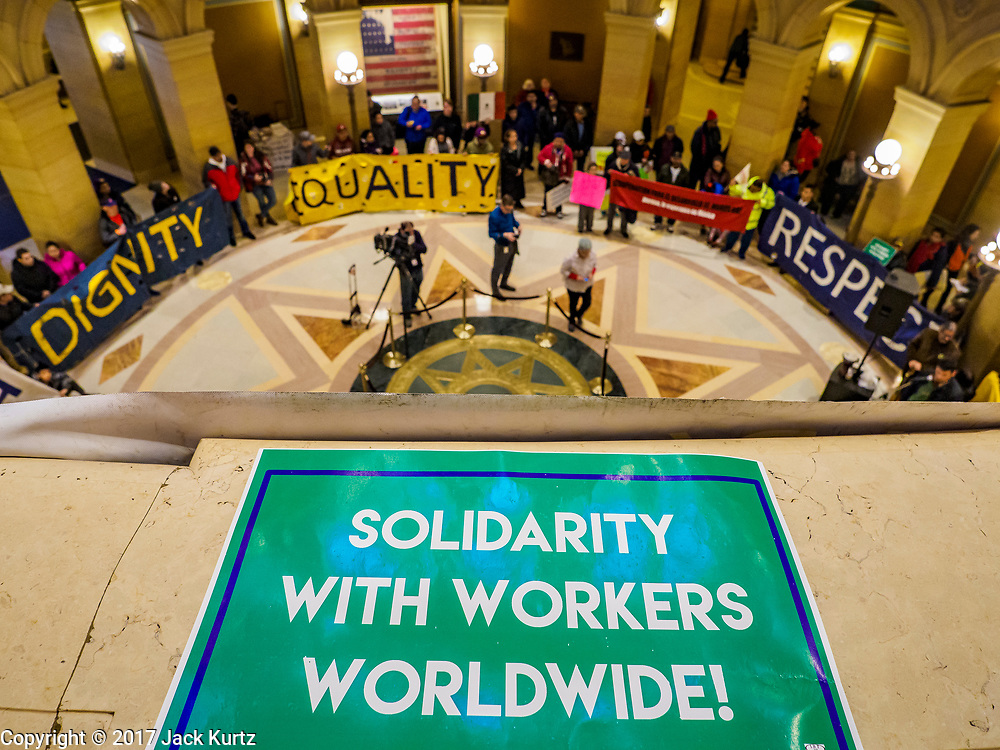 01 MAY 2017 - ST. PAUL, MN:  Immigrants' rights protesters in the rotunda of the Minnesota State Capitol. About 300 people, representing immigrants' and workers' rights organizations, marched through the Minnesota State Capitol during a demonstration to mark May Day, International Workers' Day.     PHOTO BY JACK KURTZ
