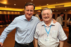 The Prime Minister David Cameron with his agent Barry Norton at the Conservative Party Conference in Manchester, Sunday October 2, 2011. Photo By Andrew Parsons / i-Images