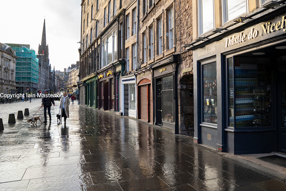 Edinburgh, Scotland, UK. 17 January 2020. On first Sunday after tightening of national lockdown rules in Scotland the streets of the Old town in Edinburgh City Centre remain very quiet with no shops open and only a couple of cafes offering takeaway drinks and food.   Iain Masterton/Alamy Live News
