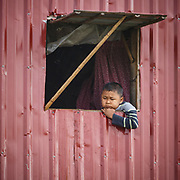 Boy waiting at the window, Lake Inle