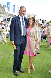 The HON.HARRY HERBERT and his wife CHICA at the 2014 Glorious Goodwood Racing Festival at Goodwood racecourse, West Sussex on 31st July 2014.