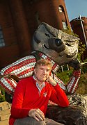 """Comedian, actor and UW graduate Brian Stack at the """"Well Red"""" statue. (Photo © Andy Manis)"""