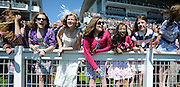 © licensed to London News Pictures. EPSOM, UK.  03/06/11. A group of young girls cheer on the race horses as they pass the finish line.  Epsom Derby Ladies Day. Sunshine and wind made for a busy Ladies Day today, 3rd June 2011.  Photo credit should read Stephen Simpson/LNP