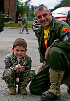 From the 2007 Fourth of July parade in Norwood MA. One of the military units of former and current solders The two Joes. I asked the boy if he wanted to be a soldier like his Dad.  No, I want to be a fireman, he answered.