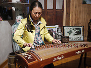 Traditional Chinese Music played on a Zheng, at the Mei Jia Wu tea plantation, Hangzhou, China