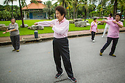 06 OCTOBER 2012 - BANGKOK, THAILAND:  Women do Tai Chi exercises early in the morning in Lumphini Park in Bangkok. The Thai government promotes exercise classes as a way staying healthy. Lumphini Park is 142 acre (57.6-hectare) park in Bangkok, Thailand. This park offers rare open public space, trees and playgrounds in the congested Thai capital. It contains an artificial lake where visitors can rent boats. Exercise classes and exercise clubs meet in the park for early morning workouts and paths around the park totalling approximately 1.55 miles (2.5 km) in length are a popular area for joggers. Cycling is only permitted during the day between the times of 5am to 3pm. Smoking is banned throughout smoking ban the park. The park was created in the 1920's and named after Lumbini, the birthplace of the Buddha in Nepal.   PHOTO BY JACK KURTZ