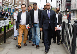 "© Licensed to London News Pictures. 05/04/2014. London, UK. Mayor of Tower Hamlets, Lutfur Rahman and supporters from the Tower Hamlets First party take part in a community walkabout in Stepney, East London on 5th April 2014 to canvas for the upcoming Mayoral election. Communities Secretary, Eric Pickles yesterday sent inspectors to start an audit of Tower Hamlets council and the Rahman administration following allegations of fraud and financial mismanagement, also reported by BBC's Panorama programme this week. Mayor Lutfur Rahman denies all allegations, which he calls ""Panorama lies"". Photo credit : Vickie Flores/LNP"