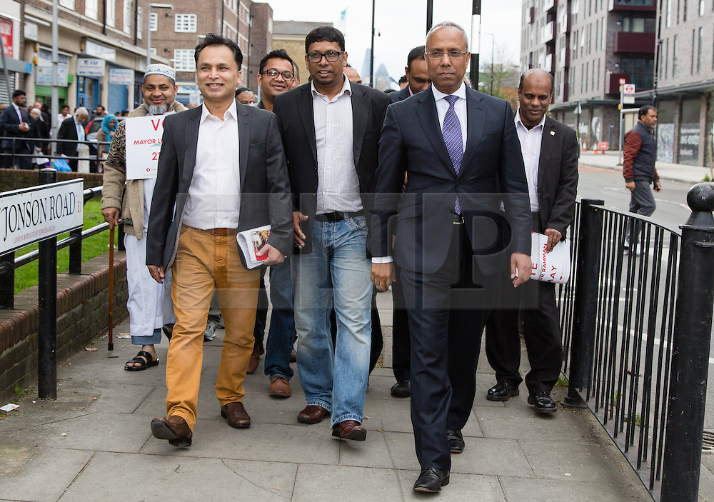 """© Licensed to London News Pictures. 05/04/2014. London, UK. Mayor of Tower Hamlets, Lutfur Rahman and supporters from the Tower Hamlets First party take part in a community walkabout in Stepney, East London on 5th April 2014 to canvas for the upcoming Mayoral election. Communities Secretary, Eric Pickles yesterday sent inspectors to start an audit of Tower Hamlets council and the Rahman administration following allegations of fraud and financial mismanagement, also reported by BBC's Panorama programme this week. Mayor Lutfur Rahman denies all allegations, which he calls """"Panorama lies"""". Photo credit : Vickie Flores/LNP"""