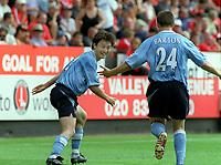 Jihai Sun (Man City) celebrates scoring goal no.3  with Joey Barton. Charlton Athletic v Manchester City. 17/8/2003. Credit : Colorsport.