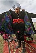 Koormoochoo Saira puts on his wedding coat and white turban.<br /> The Kyrgyz wedding ceremony of Koormoochoo Saïra (son of Yunus Amid) in Utch Djelgha summer camp, 5th August 20005.<br /> <br /> Adventure through the Afghan Pamir mountains, among the Afghan Kyrgyz and into Pakistan's Karakoram mountains. July/August 2005. Afghanistan / Pakistan.