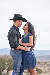 cowboy and a girl looking into each other's eyes