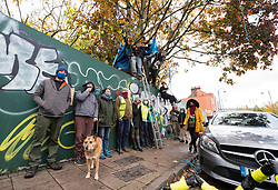 © Licensed to London News Pictures; 02/11/2020; Bristol, UK. Campaigners for the Save The M32 Maples Campaign are dismayed that this morning from 6am contractors working for a developer have cut down 2 of the 3 maple trees where the campaigners had built tree houses to protect the 3 remaining Norway Maple trees on Lower Ashley Road in the St Pauls area of Bristol close to the M32 motorway. Several people from the campaign are occupying the remaining tree and tree house. The campaign wanted the trees kept to enhance the environment and help remove pollution in what is a traffic congested area. The campaign asked the police Serious Fraud Unit to investigate allegations of a fraudulent Bristol City Council giveaway of £500,000 of public property, including the trees. Campaigners have obtained documents which show the mature trees fall outside the boundary of the land on Lower Ashley Road owned by John Garlick, and they claim the strip of land the three remaining protected trees are on belongs to Bristol City Council's highways department. Bristol City Council denies the claim and says the existing maps are inaccurate and that the trees are not on council owned land as it was all sold off by the council. Two of five trees originally there were felled on New Year's Eve, and campaigners chained themselves to remaining trees to prevent them being cut down. Photo credit: Simon Chapman/LNP.