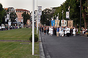 front of the candle parade held every evening by the basilica of the immaculate conception Notre Dame of Lourdes France